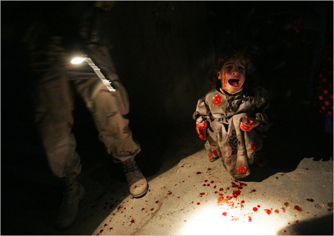 Samar Hassan screams after her parents were killed by U.S. Soldiers with the 25th Infantry Division in a shooting January 18, 2005 in Tal Afar, Iraq. (Chris Hondros/Getty Images)